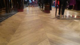 Floorrich Engineered White Oak installed in Chevron laying pattern in commercial store