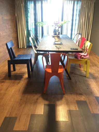 Mixed Floorrich Ontario Oak Mocha and Cyprus Novalis luxury vinyl flooring installed in residential dining room for an unique and unusual design